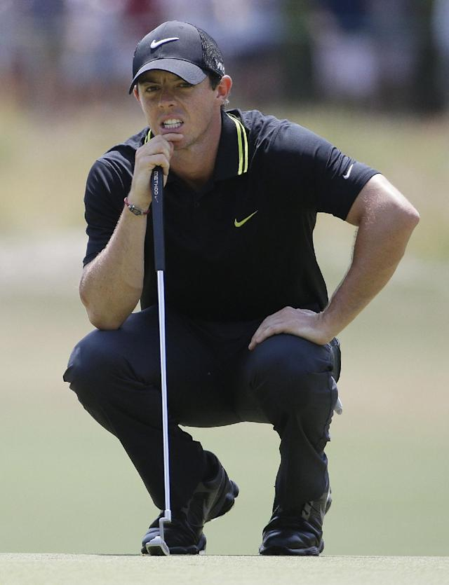 Rory McIlroy, of Northern Ireland, lines up a putt on the second hole during the third round of the U.S. Open golf tournament in Pinehurst, N.C., Saturday, June 14, 2014. (AP Photo/David Goldman)