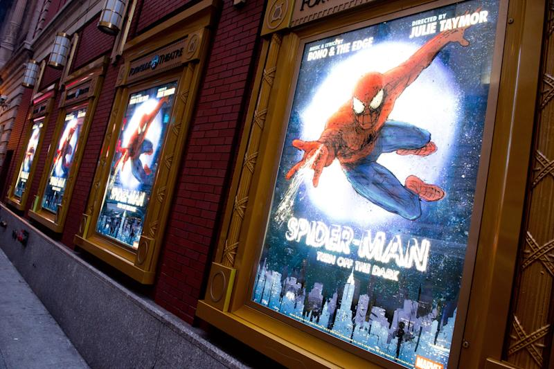 """FILE - In this Dec. 22, 2010 file photo, posters for the Broadway musical """"Spider-Man Turn: Off the Dark"""" hang outside the Foxwoods Theatre in New York. A spokesman for the show says an actor on the set of the Broadway musical was injured during a night performance, Thursday, Aug. 15, 2013. The performance was halted. The actor, who was taken to Bellevue Hospital with a serious leg injury, was not identified. (AP Photo/Charles Sykes, File)"""