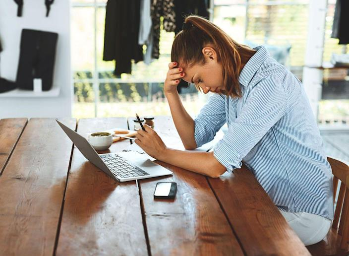 Woman is stressed tired and cant focus on her work