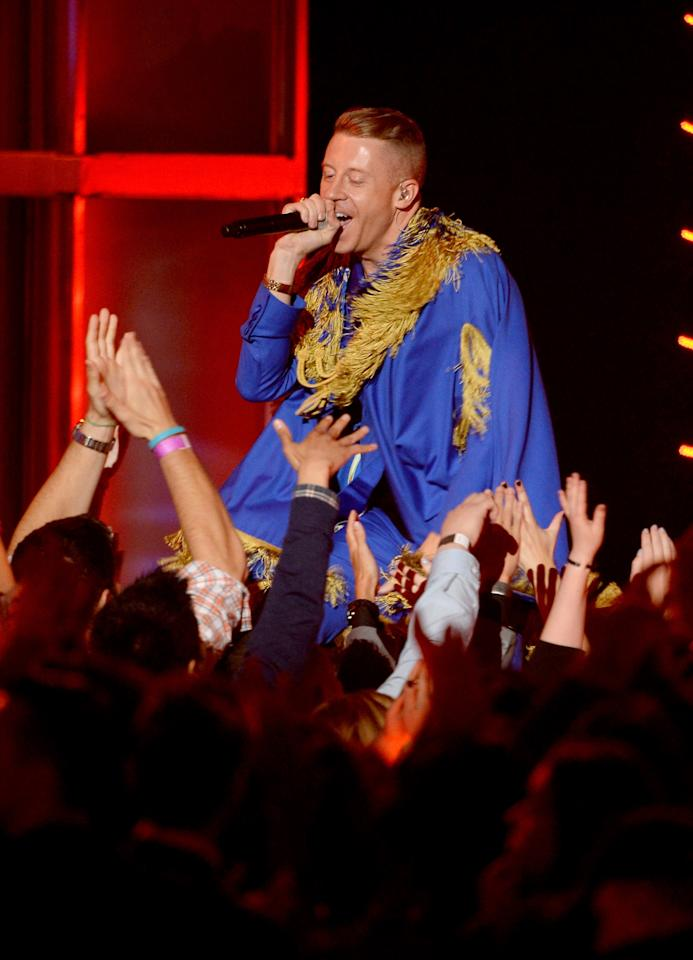 CULVER CITY, CA - APRIL 14:  Rapper Macklemore performs onstage during the 2013 MTV Movie Awards at Sony Pictures Studios on April 14, 2013 in Culver City, California.  (Photo by Kevork Djansezian/Getty Images)