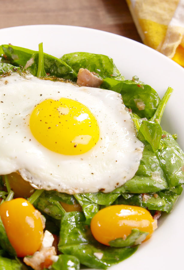 "<p>Bacon vinaigrette + yolk = the most satisfying salad you'll ever eat.</p><p>Get the recipe from <a href=""https://www.delish.com/cooking/recipe-ideas/recipes/a48540/breakfast-bacon-and-egg-salad-recipe/"" rel=""nofollow noopener"" target=""_blank"" data-ylk=""slk:Delish"" class=""link rapid-noclick-resp"">Delish</a>.</p>"