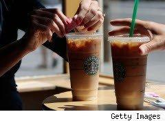Woman adds sugar to her Starbucks order