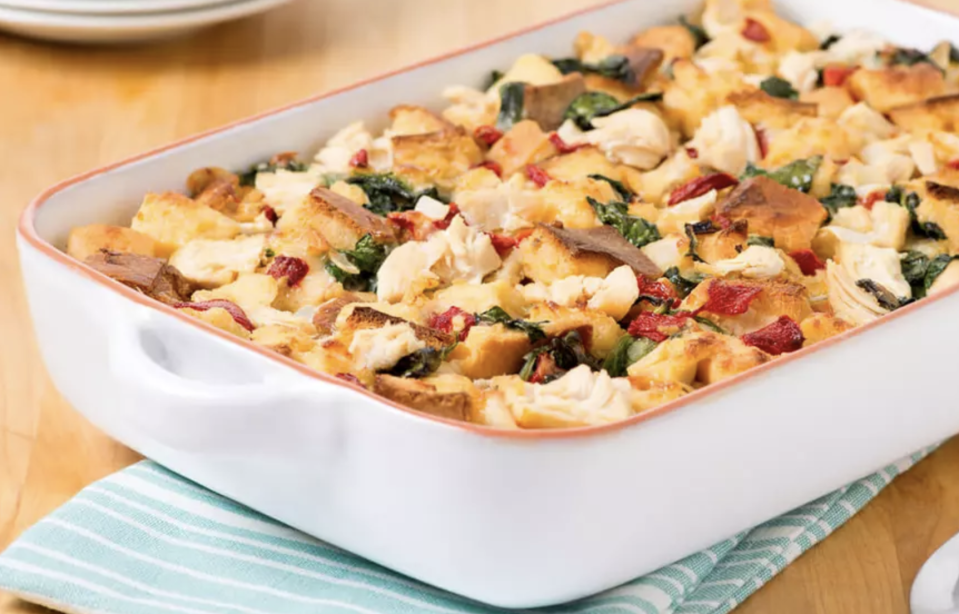 """<p>This bake is essentially a savory bread pudding with cubes of Italian bread, eggs, chicken, artichokes, spinach, garlic and lots of other flavors. And if you have a jar of roasted red peppers in your pantry, here is the place to use them. You can prepare the tray, refrigerate it and bake it just before you're ready to eat. </p> <p><a href=""""https://www.thedailymeal.com/recipes/brunch-bake-artichokes-chicken-and-roasted-red-peppers-recipe?referrer=yahoo&category=beauty_food&include_utm=1&utm_medium=referral&utm_source=yahoo&utm_campaign=feed"""" rel=""""nofollow noopener"""" target=""""_blank"""" data-ylk=""""slk:For the Brunch Bake with Artichokes, Chicken and Roasted Red Pepper recipe, click here."""" class=""""link rapid-noclick-resp"""">For the Brunch Bake with Artichokes, Chicken and Roasted Red Pepper recipe, click here. </a></p>"""