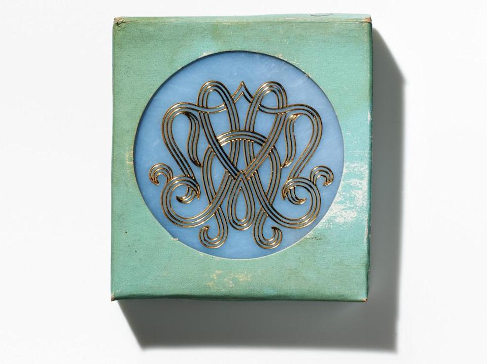 <p>The compact came in a the brand's signature pale blue box, but the compact itself was also available in pearl white, or tortoiseshell. <i>(Photo: Henry Leutwyler)</i></p>