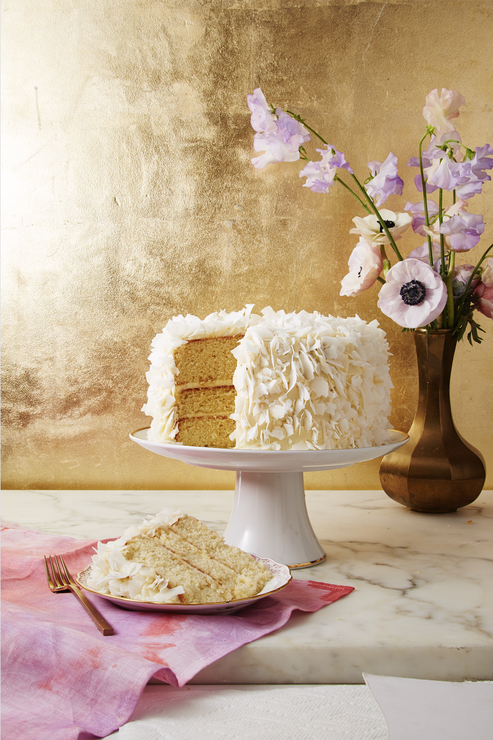 "<p>It's a holiday, why not go all out with the dessert? This triple-layer confection will turn heads.</p><p><em><a href=""https://www.goodhousekeeping.com/food-recipes/a37460/coconut-layer-cake-with-cream-cheese-frosting-recipe/"" rel=""nofollow noopener"" target=""_blank"" data-ylk=""slk:Get the recipe for Coconut Layer Cake With Cream Cheese Frosting »"" class=""link rapid-noclick-resp"">Get the recipe for Coconut Layer Cake With Cream Cheese Frosting »</a></em></p><p><strong>RELATED: </strong><a href=""https://www.goodhousekeeping.com/holidays/easter-ideas/g4156/easter-cakes/"" rel=""nofollow noopener"" target=""_blank"" data-ylk=""slk:40 Beautiful Easter Cakes That Anyone Can Make"" class=""link rapid-noclick-resp"">40 Beautiful Easter Cakes That Anyone Can Make</a><br></p>"