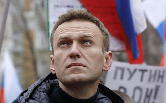 Russian opposition leader Alexei Navalny attends a rally in memory of politician Boris Nemtsov in Moscow - REUTERS