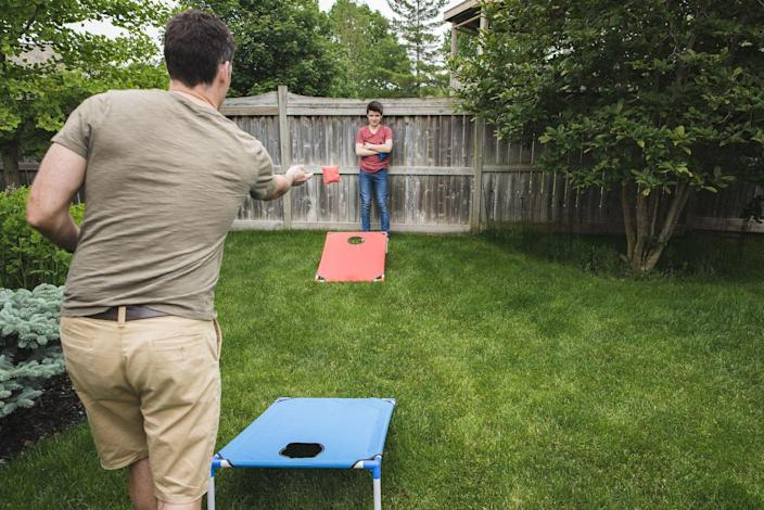 """<p>Get ready to get competitive. Cornhole is an easy game to learn, but a hard one to master. Have your dad feeling like his old college self again with this fun tailgating game. If you don't have a cornhole set yet, it might be a good time to <a href=""""https://www.amazon.com/GoSports-Classic-Cornhole-Rustic-Finish/dp/B07TB5LNB2/ref=sr_1_2?tag=syn-yahoo-20&ascsubtag=%5Bartid%7C10070.g.2988%5Bsrc%7Cyahoo-us"""" rel=""""nofollow noopener"""" target=""""_blank"""" data-ylk=""""slk:buy one"""" class=""""link rapid-noclick-resp"""">buy one</a>: it'll get <em>tons </em>of use in the summer months. </p>"""
