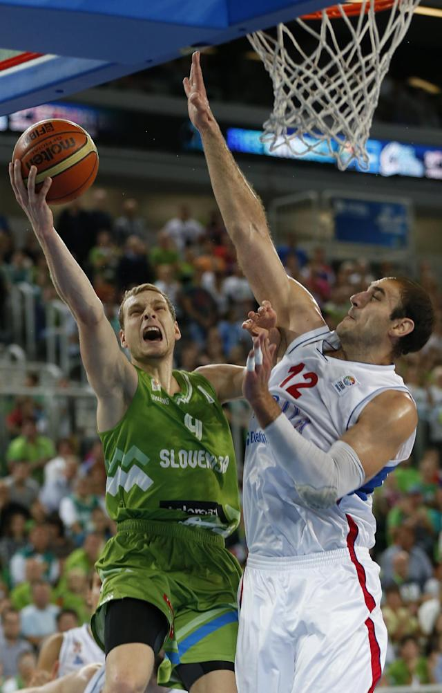 Serbia's Nenad Krstic, right, blocks Slovenia's Jaka Blazic during their EuroBasket European Basketball Championship classification 5th to 8th place play off match in Ljubljana, Slovenia, Thursday, Sept. 19, 2013. (AP Photo/Petr David Josek)