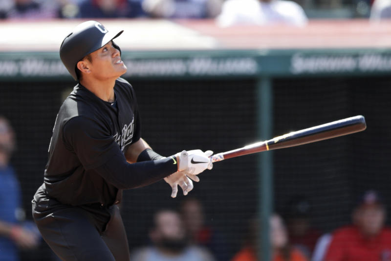 Cleveland Indians' Yu Chang watches his ball after hitting a triple in the seventh inning in a baseball game against the Kansas City Royals, Sunday, Aug. 25, 2019, in Cleveland. (AP Photo/Tony Dejak)