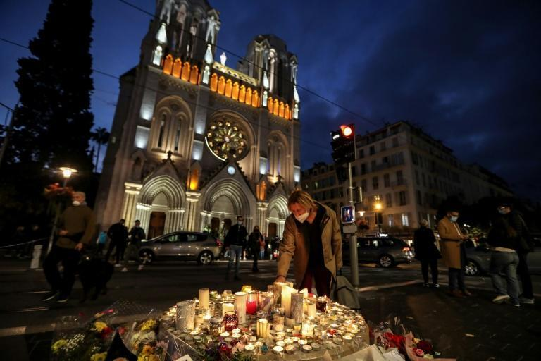 Tributes placed outside Nice's Notre-Dame cathedral on Friday, where an attacker killed three people the day before