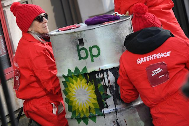 Greenpeace activists chained to oil barrels outside the headquarters of oil giant BP in London on February 5, 2020 — Looney's first day as chief executive. (DANIEL LEAL-OLIVAS/AFP via Getty Images)