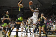 Connecticut's Christyn Williams (13) shoots over Oregon's Satou Sabally, front left, in the first half of an NCAA college basketball game, Monday, Feb. 3, 2020, in Storrs, Conn. (AP Photo/Jessica Hill)