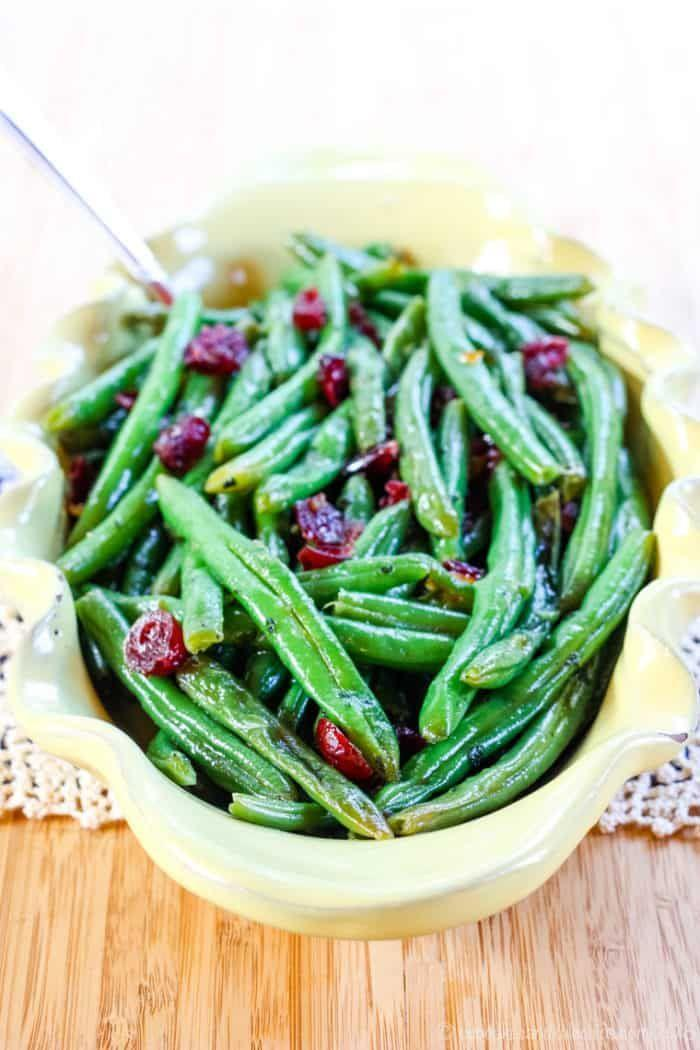 "<p>If you like your greens with a little touch of sweetness, you'll love this classic side dressed up with the double-punch of orange marmalade and juicy crans.</p><p><em><a href=""https://cupcakesandkalechips.com/cranberry-orange-glazed-green-beans/"" rel=""nofollow noopener"" target=""_blank"" data-ylk=""slk:Get the recipe from Cupcakes and Kale Chips »"" class=""link rapid-noclick-resp"">Get the recipe from Cupcakes and Kale Chips »</a></em></p>"