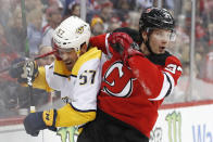 New Jersey Devils center Pavel Zacha (37), of the Czech Republic, checks Nashville Predators defenseman Dante Fabbro (57) against the boards during the second period of an NHL hockey game, Thursday, Jan. 30, 2020, in Newark, N.J. (AP Photo/Kathy Willens)