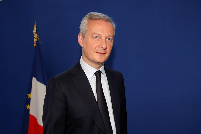French Finance Minister Bruno Le Maire walks at the Bercy Finance Ministry in Paris