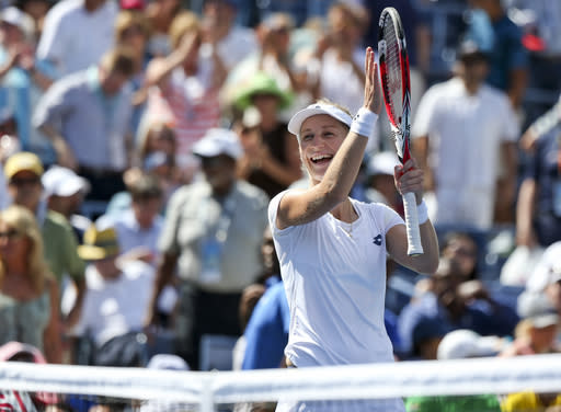 Ekaterina Makarova, of Russia, reacts after defeating Victoria Azarenka, of Belarus, in two sets during the quarterfinals of the 2014 U.S. Open tennis tournament, Wednesday, Sept. 3, 2014, in New York. (AP Photo/Mike Groll)