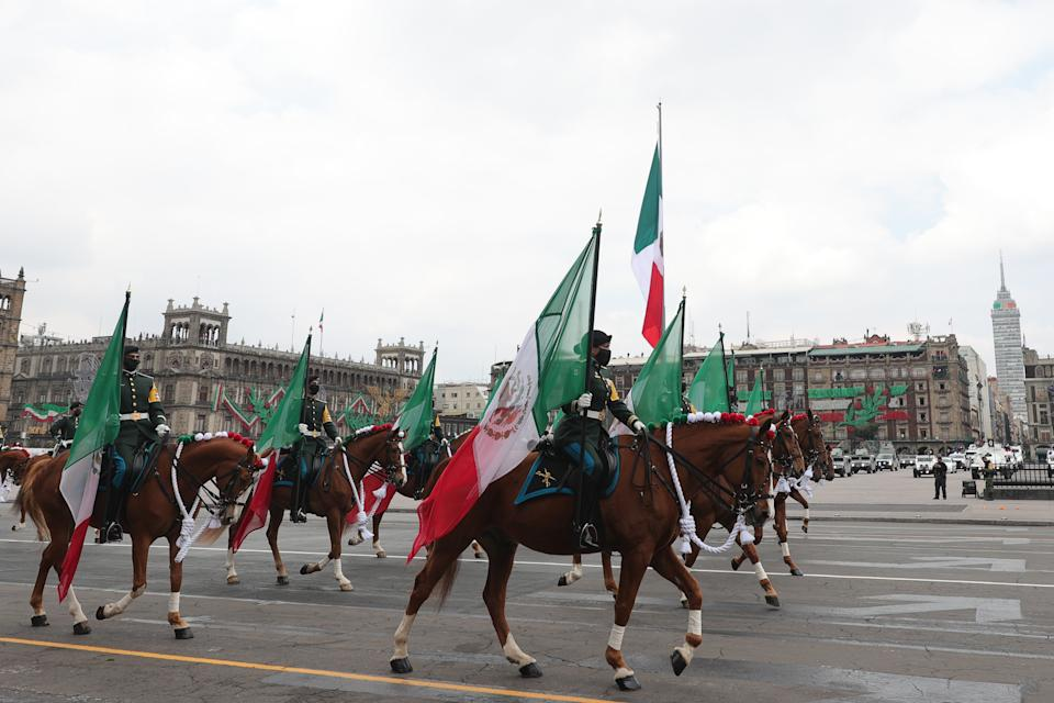 VARIOUS CITIES, MEXICO - SEPTEMBER 16: Soldiers march riding horses during the Independence Day military parade at Zocalo Square on September 16, 2020 in Various Cities, Mexico. This year El Zocalo remains closed for general public due to coronavirus restrictions. Every September 16 Mexico celebrates the beginning of the revolution uprising of 1810. (Photo by Hector Vivas/Getty Images)