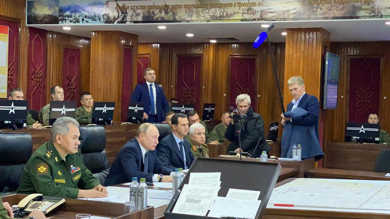 This image released by the Syrian Presidency shows Russian President Vladimir Putin, second left, in a meeting with Syrian President Bashar Assad and others, in Damascus, Syria on Tuesday, Jan. 7, 2020. Putin's visit is the second to the war-torn country where his troops have been fighting alongside Syrian government forces since 2015. (Syrian Presidency via AP)