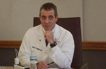 Dr. David Steinberg, Chief of Staff, Saint Joseph Mercy Health System sits in a meeting at Saint Joseph Mercy hospital in Ypsilanti, Michigan, U.S., August 23, 2017. Picture taken August 23, 2017. REUTERS/Rebecca Cook