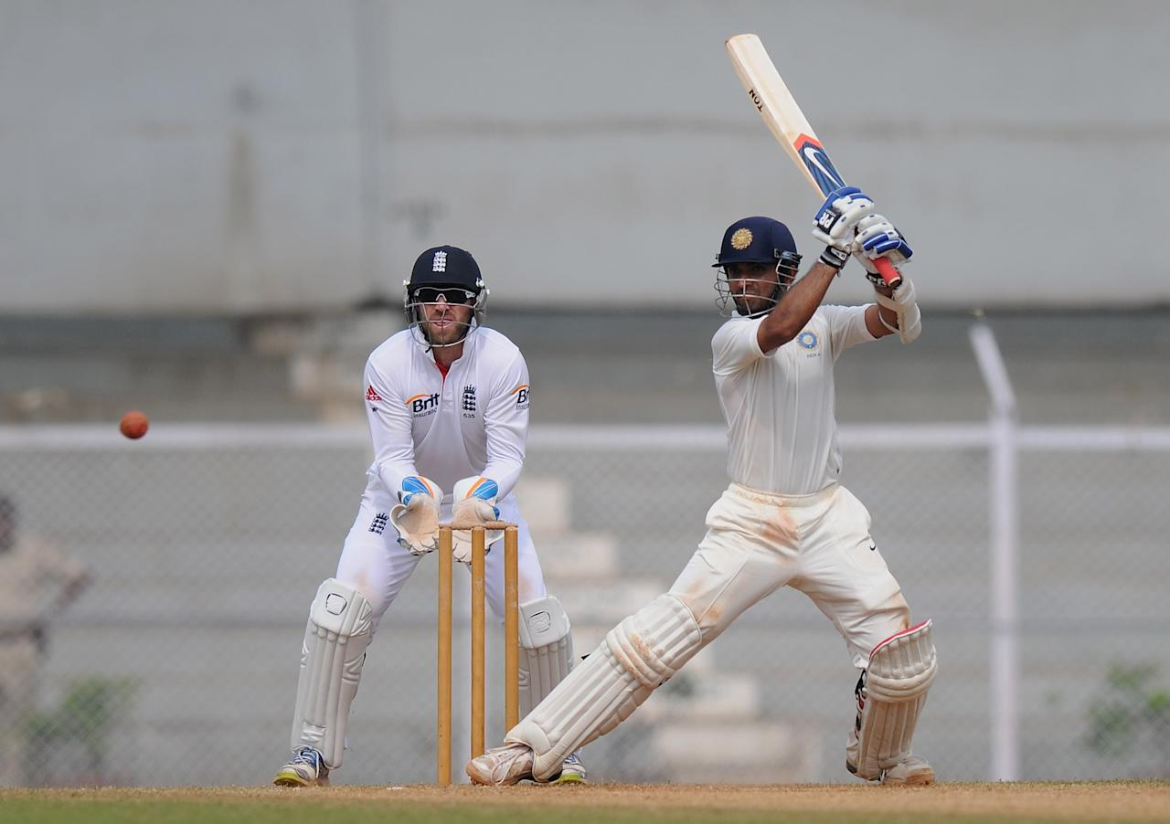 """MUMBAI, INDIA - NOVEMBER 01:  Ajinkya Rahane (R) of India 'A"""" bats as Matt Prior of England looks on during the final day of the first practice match between England and India 'A' at the CCI (Cricket Club of India) ground, on November 1, 2012 in Mumbai, India.  (Photo by Pal Pillai/Getty Images)"""