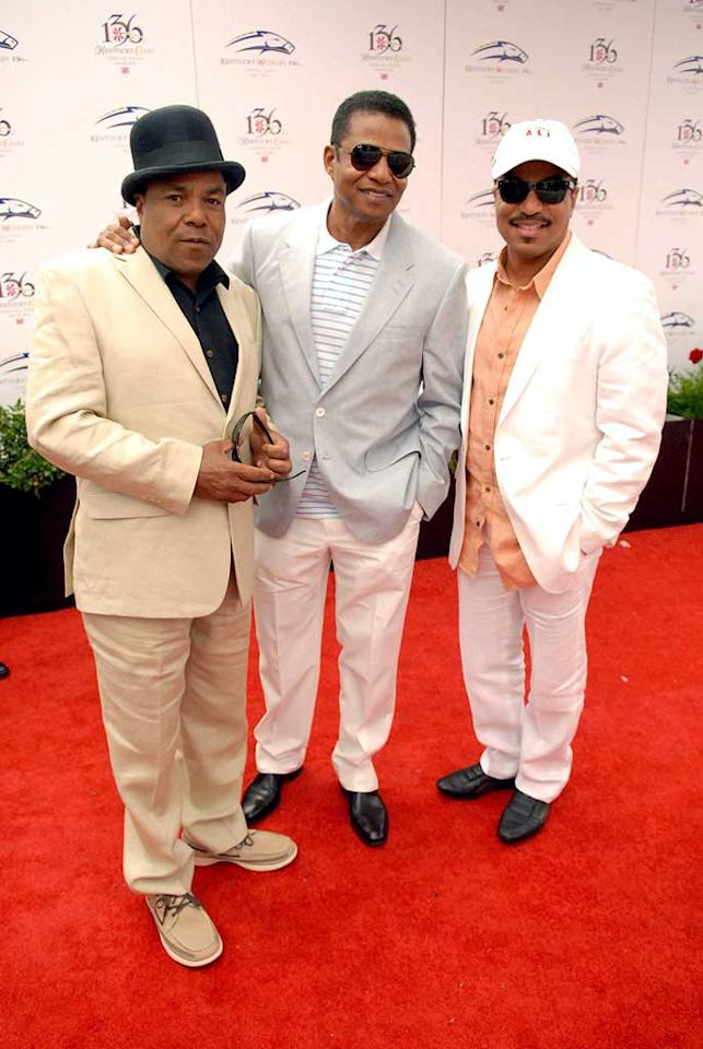 """Michael Jackson's brothers -- Tito, Marlon, and Jackie -- donned pastels for the day, but only Tito sported a traditional hat for the festivities. Besides the horse race, the Kentucky Derby gave the siblings a chance to catch up with another attendee, family friend Smokey Robinson. Stephen J. Cohen/<a href=""""http://www.filmmagic.com/"""" target=""""new"""">FilmMagic.com</a> - May 1, 2010"""
