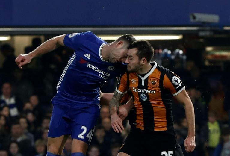 Ryan Mason (right) suffered a career-ending fractured skull in a clash of heads with Gary Cahill while playing for Hull against Chelsea