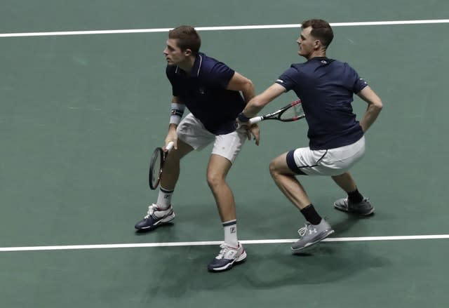 Neal Skupski, left, and Jamie Murray during their exciting doubles match against Spain (Bernat Armangue/AP)