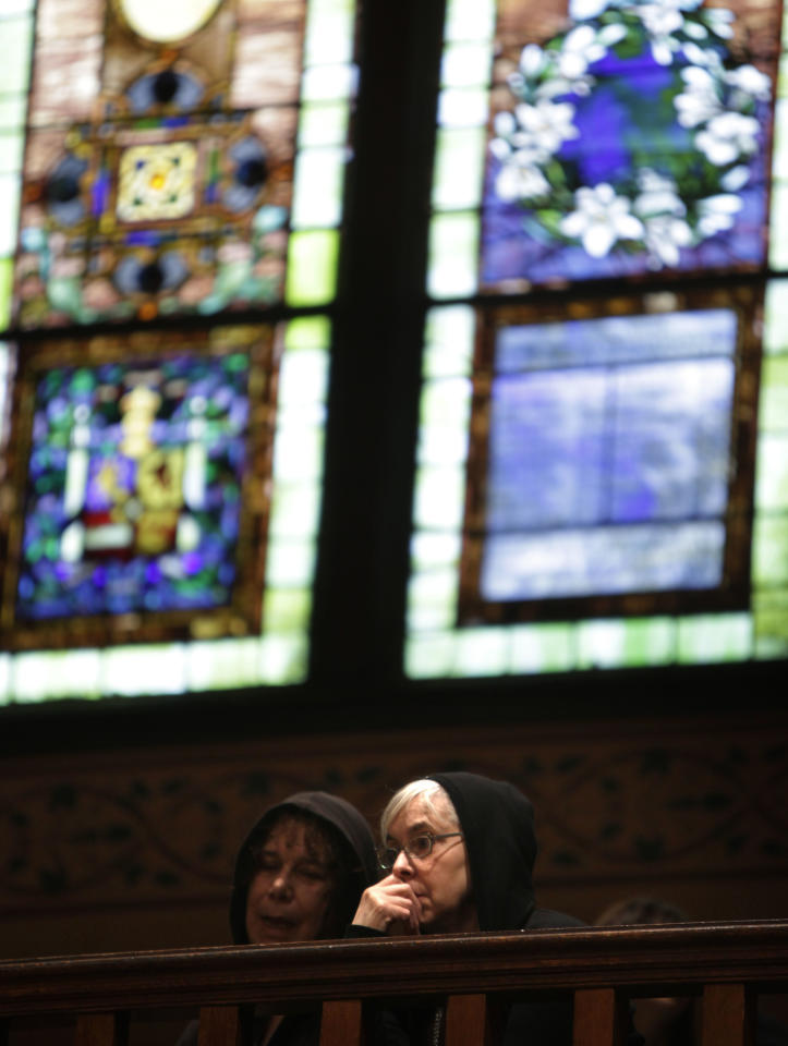 Women sit in the balcony before a service at Middle Collegiate Church in New York, Sunday, March 25, 2012. Church-goers were invited to wear hoodies to services to show their support for justice in the case of Trayvon Martin, an unarmed black teenager who was wearing a hoodie on the night he was killed by a neighborhood watch captain in Florida. (AP Photo/Seth Wenig)