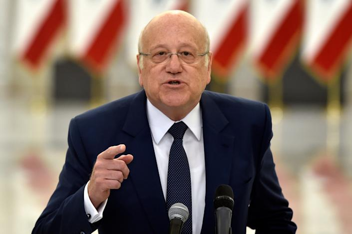 Prime Minister-designate Najib Mikati speaks to the media after his meeting with President Michel Aoun and assigned to form a new government (EPA)