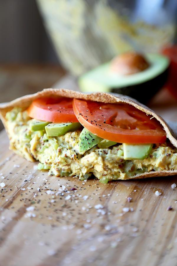 """<p>The Tuna Sandwich will never go out of style. Crunchy, creamy, tangy, and savoury, this recipe is tuna with a personal touch. Try it on whole wheat bread, or pack it into a whole wheat pita pocket. <i>[Image: Pickled Plum]</i></p><p>Get the recipe from: <b><a href=""""http://www.pickledplum.com/my-favorite-tuna-sandwich-recipe/"""" rel=""""nofollow noopener"""" target=""""_blank"""" data-ylk=""""slk:Pickled Plum"""" class=""""link rapid-noclick-resp"""">Pickled Plum</a></b></p>"""