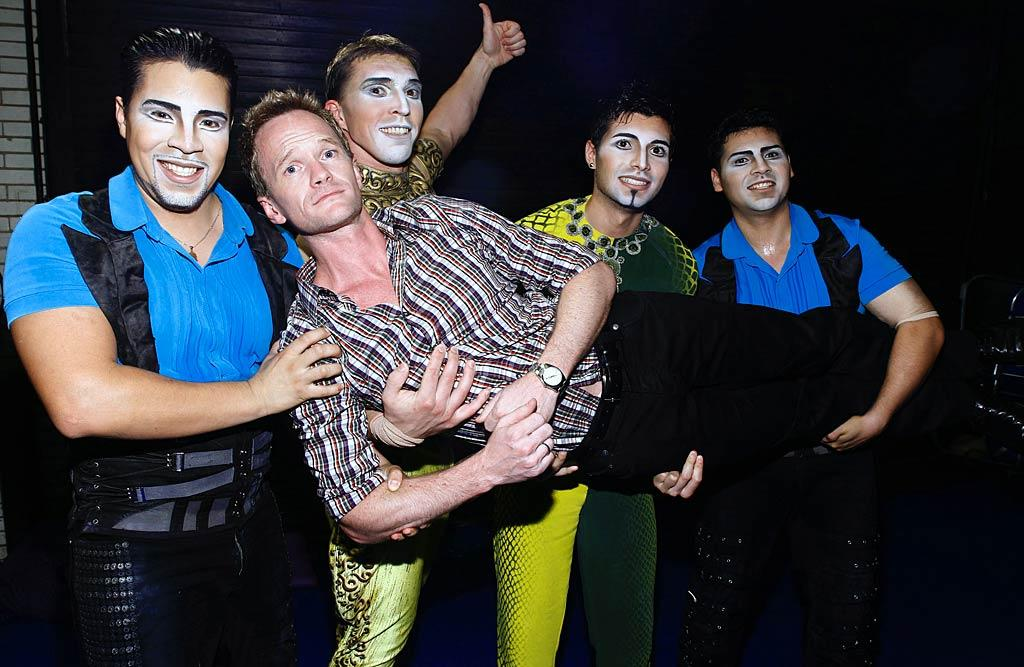 "Neil Patrick Harris looked less than confident about joining in on the act when he visited with a few members of Cirque Du Soleil ""Zarkana"" at New York's Radio City Music Hall on Thursday. Brian Ach/<a href=""http://www.wireimage.com"" target=""new"">WireImage.com</a> - July 28, 2011"