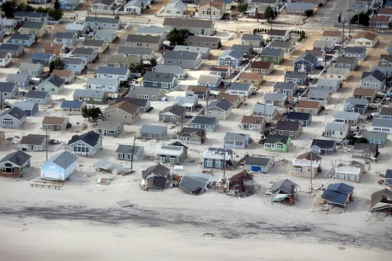 The view of storm damage over the Atlantic Coast in Seaside Heights, N.J., Wednesday, Oct. 31, 2012, from a helicopter traveling behind the helicopter carrying President Obama and New Jersey Gov. Chris Christie, as they viewed storm damage from superstorm Sandy. (AP Photo/Doug Mills, Pool)