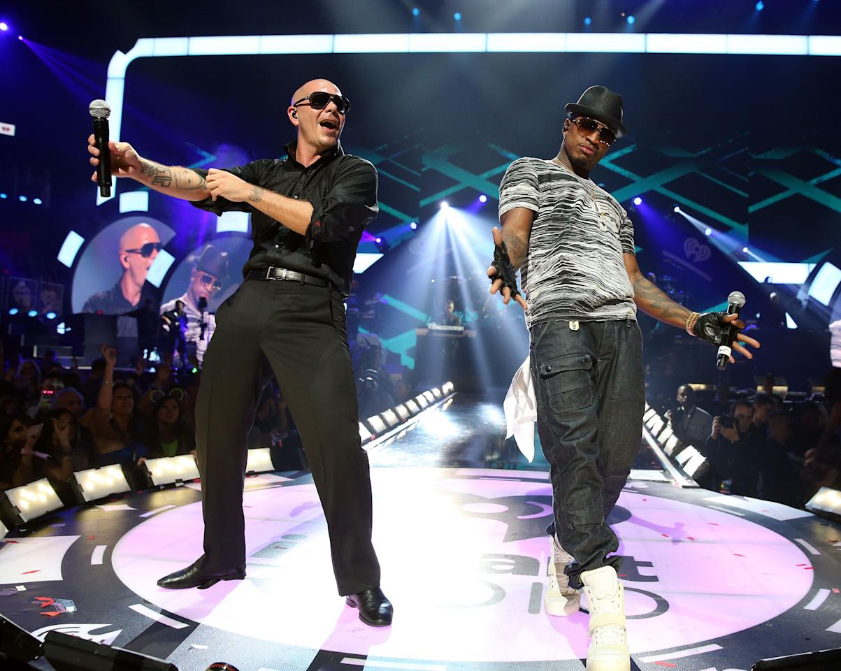 Rapper Pitbull (L) and singer/songwriter Ne-Yo perform onstage during the 2012 iHeartRadio Music Festival at the MGM Grand Garden Arena on September 22, 2012 in Las Vegas, Nevada.  (Photo by Christopher Polk/Getty Images for Clear Channel)