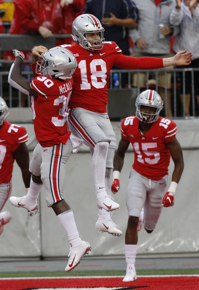Ohio State quarterback Tate Martell (18) celebrates his touchdown against Rutgers during the second half of an NCAA college football game Saturday, Sept. 8, 2018, in Columbus, Ohio. Ohio State beat Rutgers 52-3. (AP Photo/Jay LaPrete)