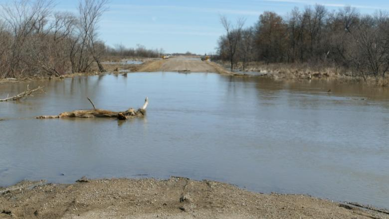 Flooding creek cuts off roads, floods basements in western Manitoba First Nation
