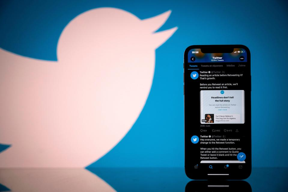 Photograph taken on 26 October, 2020, shows the logo of US social network Twitter displayed on the screen of a smartphone and a tablet in Toulouse, southern France (AFP via Getty Images)