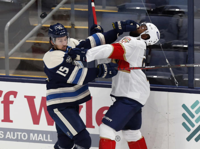 Columbus Blue Jackets defenseman Michael Del Zotto, left, shoves Florida Panthers forward Anthony Duclair during the second period of an NHL hockey game in Columbus, Ohio, Tuesday, Jan. 26, 2021. (AP Photo/Paul Vernon)