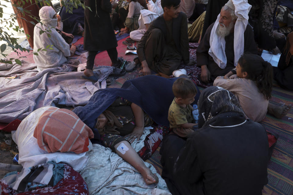 Internally displaced Afghan women from northern provinces, who fled their home due to fighting between the Taliban and Afghan security personnel, receive medical care in a public park in Kabul, Afghanistan. Source: AP Photo/Rahmat Gul