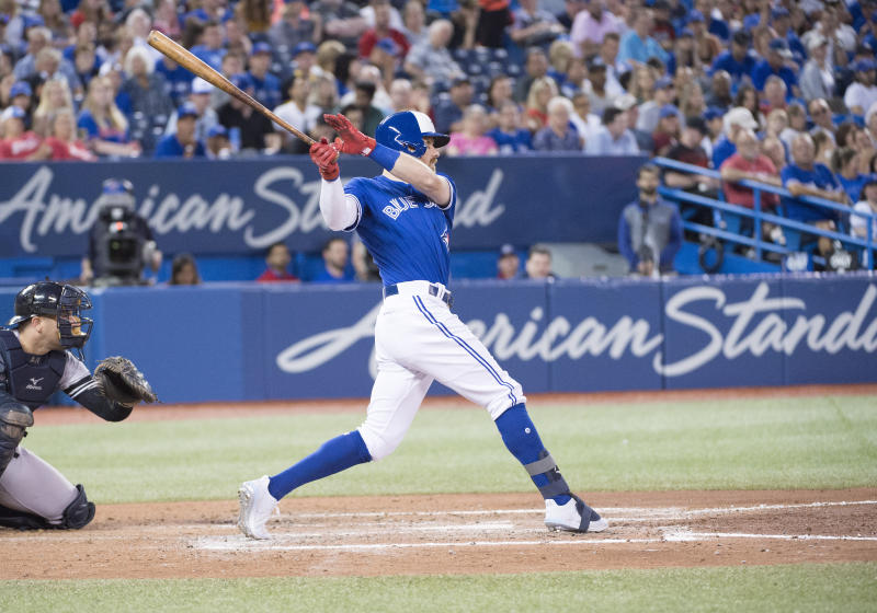 Aug 8, 2019; Toronto, Ontario, CAN;Toronto Blue Jays center fielder Derek Fisher (20) hits a home run during the fifth inning against the New York Yankees at Rogers Centre. Mandatory Credit: Nick Turchiaro-USA TODAY Sports