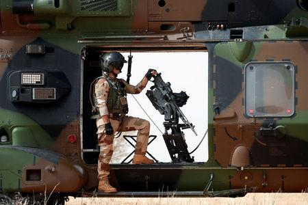 FILE PHOTO: A French soldier stands by a mounted machine gun as he surveys the area during the regional anti-insurgent Operation Barkhane in Inaloglog, Mali, October 17, 2017. REUTERS/Benoit Tessier/File Photo