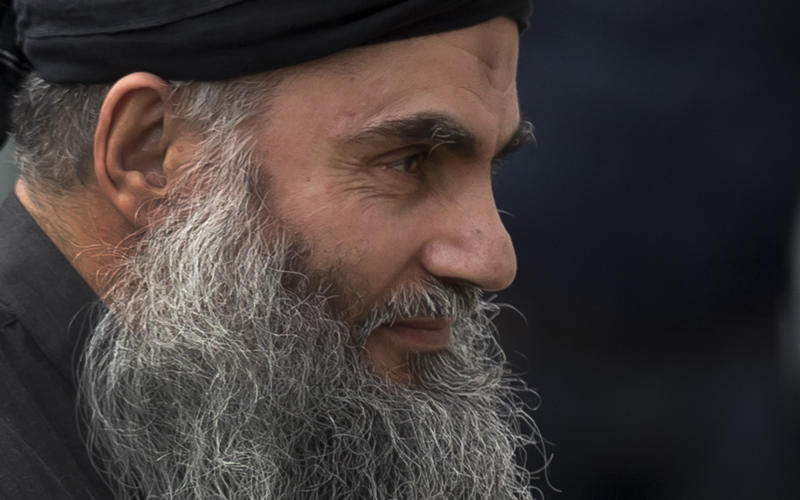 Abu Qatada arrives back at his residence in London after being freed from prison, Tuesday, Nov. 13, 2012.  The radical Islamist cleric described by prosecutors as a key al-Qaida operative in Europe was freed from prison Tuesday after a court ruled he cannot be deported from Britain to Jordan to face terrorism charges. Britain's government has attempted since 2001 to expel Abu Qatada, a Palestinian-born Jordanian cleric convicted in Jordan over terror plots in 1999 and 2000, but has been repeatedly thwarted by European and British courts. (AP Photo/Matt Dunham)