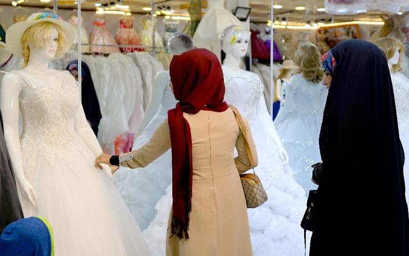 Women and girls often suffer under patriarchal systems, with many forced to marry against their will, subject to domestic abuse and deprived of an education (AFP Photo/Haidar HAMDANI)