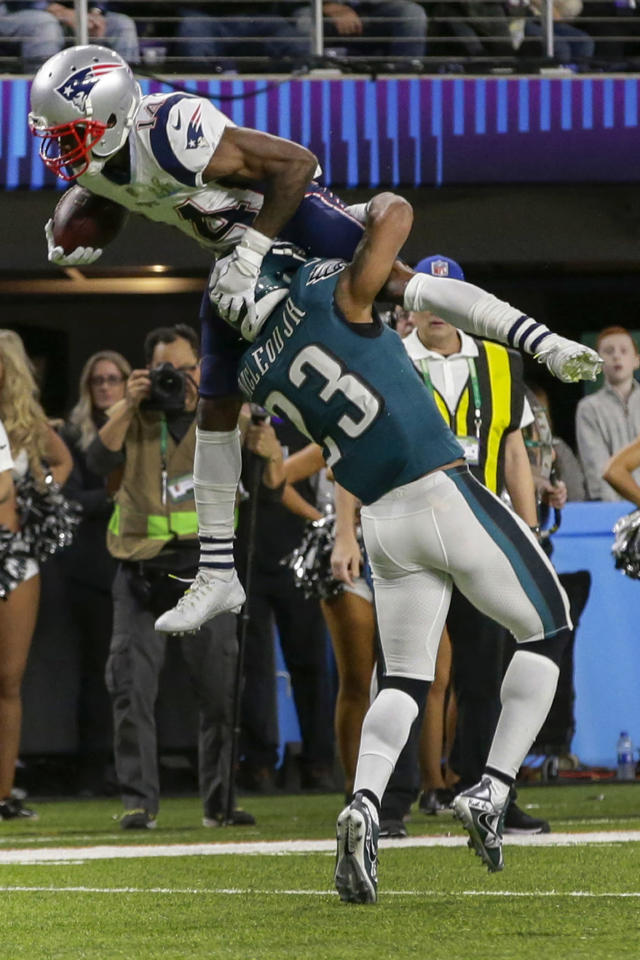 <p>New England Patriots wide receiver Brandin Cooks (14), leaps over Philadelphia Eagles free safety Rodney McLeod (23), during the first half of the NFL Super Bowl 52 football game, Sunday, Feb. 4, 2018, in Minneapolis. (AP Photo/Frank Franklin II) </p>