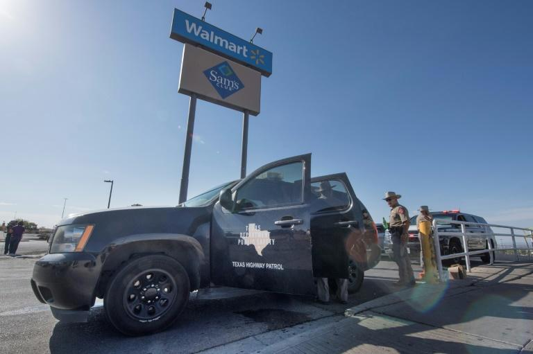 Texas State Troopers keep watch outside the Cielo Vista Mall WalMart where a shooting left 20 people dead in El Paso, Texas