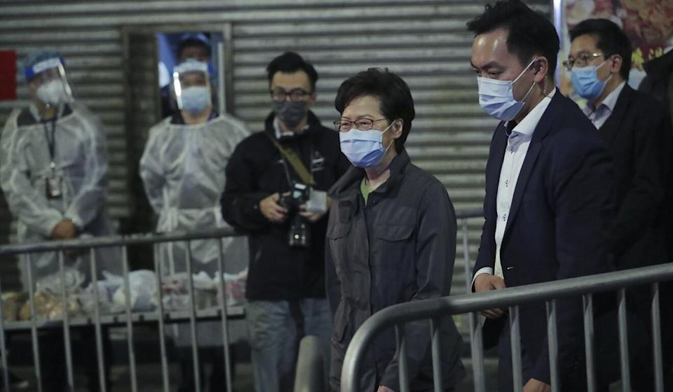 Carrie Lam on a recent visit to a locked-down area. Photo: Bloomberg