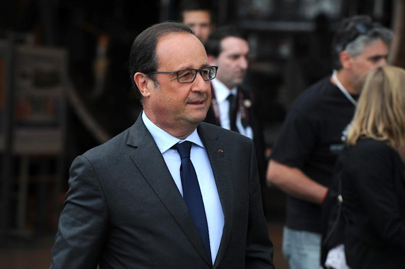 France's President Francois Hollande will present three young Americans and a British man with the country's top Legion d'Honneur medal at a ceremony on Monday (AFP Photo/Jean-Pierre Clatot)
