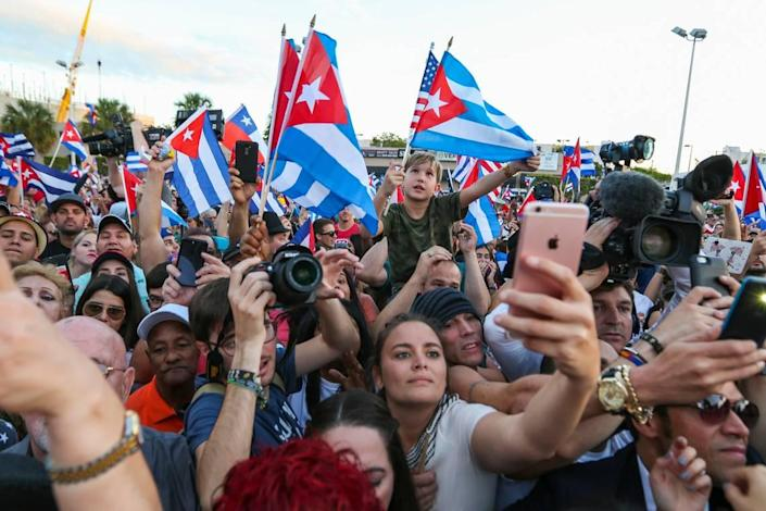Hundreds of Cuban Americans gather in front of Versailles restaurant in Miami's Little Havana after Fidel Castro's death.
