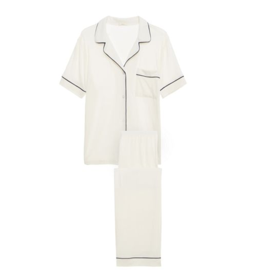 """<p>No need to cling to that threadbare old t-shirt that you """"borrowed"""" from an ex so long ago. This impossibly soft, menswear-inspired set from Eberjey is the perfect upgrade for an indulgent night in.</p> <p><strong>$118</strong> (<a href=""""https://www.journelle.com/products/eberjey-gisele-short-sleeve-pant-set-144223?color=1423"""" rel=""""nofollow"""">Shop Now</a>)</p>"""