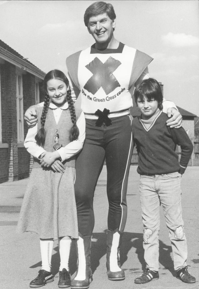 David Prowse as the Green Cross Man, the superhero of road safety.
