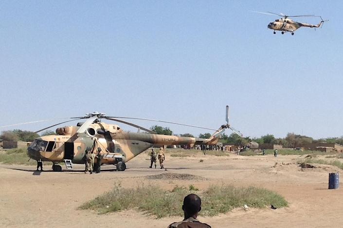 Mi-8 attack helicopters are seen in Fotokol, Cameroon, on February 1, 2015, after an operation in nearby Gamboru, Nigeria (AFP Photo/Stephane Yas)